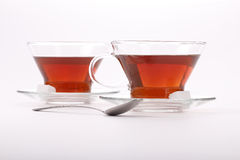 Two elegant cups of black tea. Front view of two elegant cups of black tea Royalty Free Stock Image