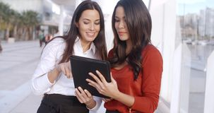 Two Elegant Dressed Business Women Talking. Two Happy  Smiling  Elegant Dressed Business Women Talking With Each Other About Their Project on Tablet Device. They stock video