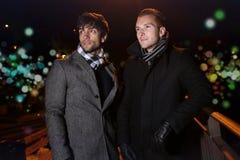 Two elegant men posing during the night Royalty Free Stock Images