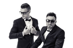 Two elegant men in suit and bowtie isolated Stock Photo