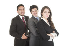Two elegant men and a woman in suits posing Stock Photos