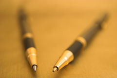 Two elegant Pens. Two Pens on Gold Background Royalty Free Stock Photo