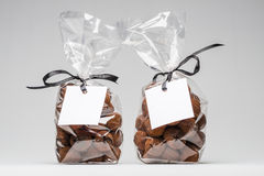 Two elegant plastic bags of chocolate truffles for Christmas gif Royalty Free Stock Photos