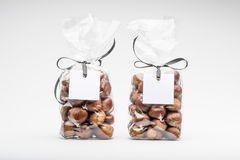 Two elegant plastic bags of sweet chestnuts for gift Stock Photo