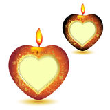Two elegant red candles. With heart shape, gold decorations and space for text for Valentine's Day Royalty Free Stock Photo
