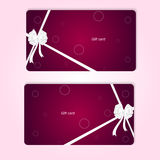 Two elegant red horizontal gift cards with ribbons and white bow. Royalty Free Stock Image