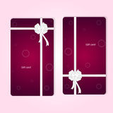 Two elegant red vertical gift cards with ribbons and white bow. Royalty Free Stock Photos