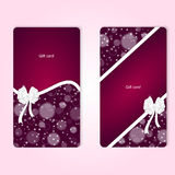 Two elegant red vertical gift cards with white ribbons and white bows. Royalty Free Stock Photo