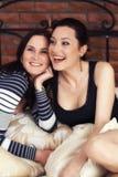 Two elegant sisters looking at camera Royalty Free Stock Photo