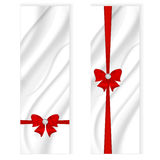 Two elegant silk vertical banner, white color with a silvery tint and a red bow with ribbon. Vector Royalty Free Stock Photo