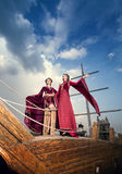 Two elegant woman in extravagant antique luxury clothes on boat Stock Photo