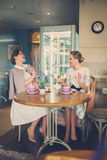 Two elegant young ladies in a cafe.  royalty free stock photos