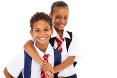 Two elementary friends. Two happy elementary school friends on white Stock Images