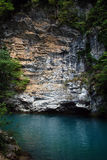 Two elements. Blue lake on a background of a rock royalty free stock photo