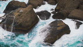 Two elements. the waves of the sea rolled on coastal rocks. stock footage
