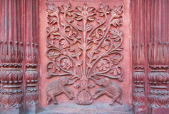 Two elephant under a tree of life. Bas-relief on the wall of an ancient temple Stock Image