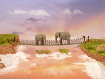 Two elephants on a bridge in the sky Royalty Free Stock Photos