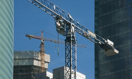 Two elevating cranes Stock Photography