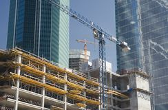 Two elevating cranes on a construction site Stock Photography