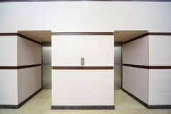 Two elevators with closed metallic doors Stock Photography
