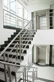Two elevators and stairs Stock Photos