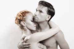 Two embracing lovers with silver make-up Royalty Free Stock Image