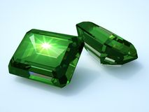 Two emerald precious stone. With reflection Royalty Free Stock Photos