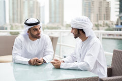 Two Emirati Arab Men Sitting in a Cafeshop Royalty Free Stock Photo