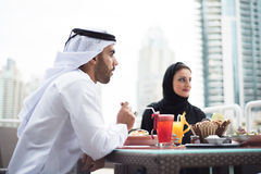 Two Emirati Arab Men Sitting in a Cafeshop Stock Images