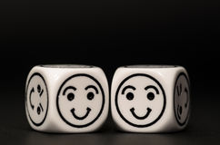 Two emoticon dice with happy expression sketch Royalty Free Stock Photos