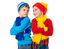 Two emotional kids in winter clothes Stock Images