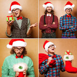 Two emotional Santa Claus dressed in clothes hipster standing ne Stock Photography