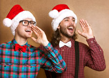 Two emotional Santa Claus Stock Photography