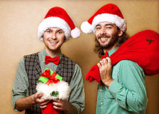 Two emotional Santa Claus Stock Images