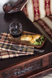Two empanadas and a glass of wine in a chic retreat. Stock Photography