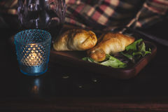 Two empanadas and a glass of wine in a chic retreat. Stock Images