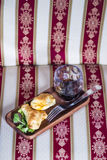 Two empanadas and a glass of wine in a chic retreat. Stock Photo