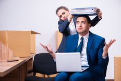 The two employees being fired from their work. Two employees being fired from their work royalty free stock images