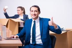 The two employees being fired from their work. Two employees being fired from their work stock photo