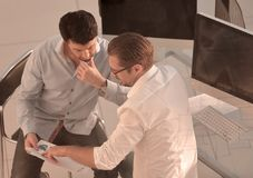 Two employees discussing financial data. royalty free stock images