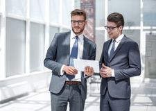 Two employees standing in the office stock image