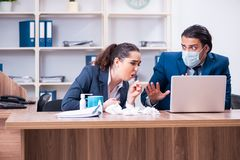 The two employees suffering at workplace. Two employees suffering at workplace royalty free stock photo