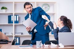 The two employees suffering at workplace. Two employees suffering at workplace stock image