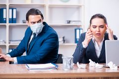 The two employees suffering at workplace. Two employees suffering at workplace stock photography