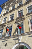 Two employees suspended at a height of washing Windows Royalty Free Stock Image