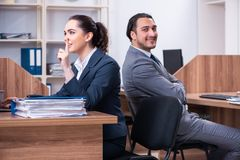 The two employees working in the office. Two employees working in the office royalty free stock image