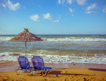 Two empty beach chair with umbrella Royalty Free Stock Photos