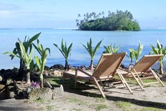 Two empty beach seats on Muri lagoon in Rarotonga Cook Islands Royalty Free Stock Photography