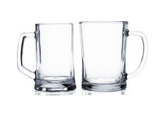 Two empty beer mugs on white Royalty Free Stock Photography