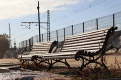 Two empty benches in retro style stock photography